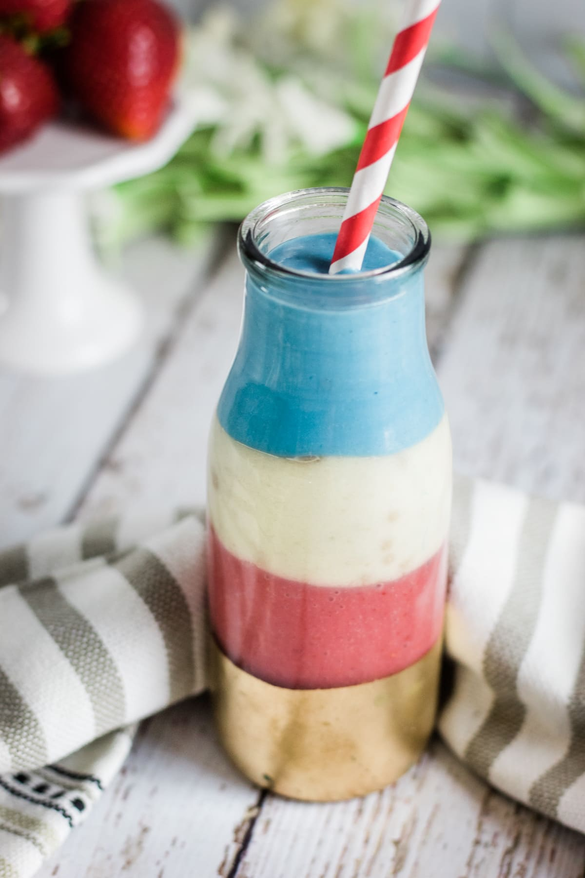 red white and blue smoothie with straw